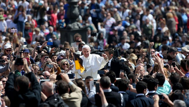 Pope Francis leaves St. Peter's Square at the end of the Easter Mass on April 16, 2017, in Vatican City.