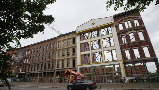 Construction continues on the facades of the Whiskey Row buildings along Main Street in downtown Louisville. April 28, 2017