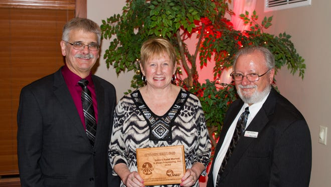 Mary Sailer (center) accepts the 2017 CAFES Outstanding Service Award for her son, Jack Sailer at the 51st Annual Scholarship and Awards Banquet at UW-River Falls. She is joined by Gary Onan (left) and Dale Gallenberg, Dean of the College of Agriculture, Food and Environmental Sciences at UW-River Falls.