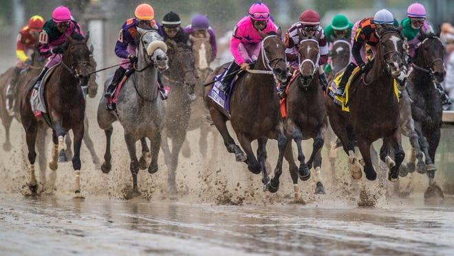 Competitors in the Kentucky Oaks come down the first stretch at Churchill Downs. May 5, 2017
