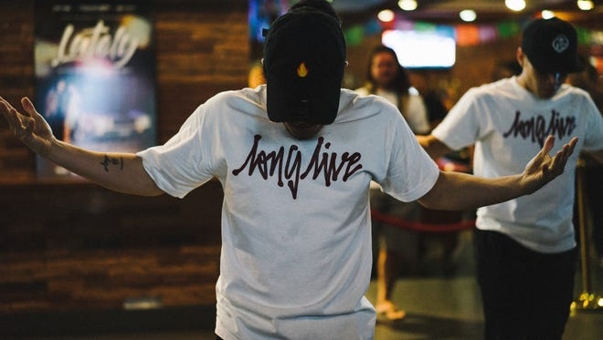 "Adrian Calugay wears a Long Live brand T-shirt while performing at Brix in Tumon at the video release party for ""Lately"" by local singer Jed Antonio."