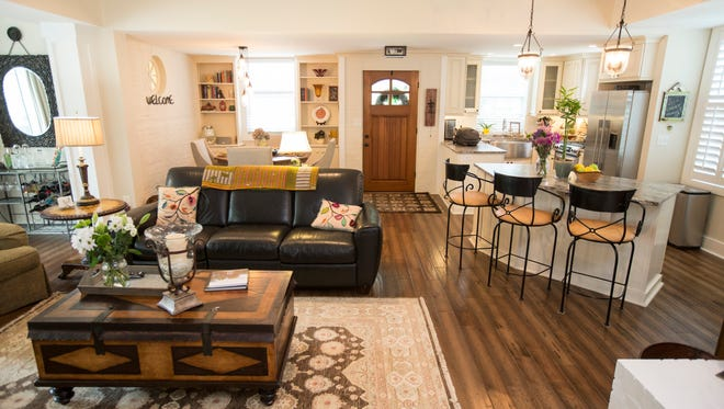 An overview of the living room, kitchen and dining area inside at the remodeled barn home of Linda Hayes. The home has an open floor plan, creating and inviting space with lots of room. May 17, 2017