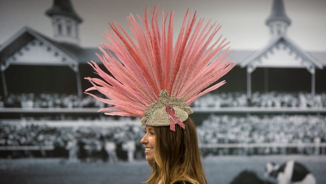 Brittany Gorter, Director of Marketing and Communications at the Kentucky Derby Museum modeled one of the hats that will be on display for an exhibit featuring clothing worn to the Derby. June 5, 2017.