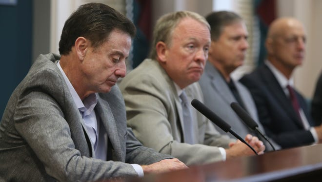 University of Louisville basketball coach Rick Pitino, left, Interim President Dr. Greg Postel, Athletic Director Tom Jurich and consultant Chuck Smrt, right, listen to a question during a press conference to address the NCAA penalties placed on the school for sex parties that occurred involving members of the men's baksetball team and recuits. June 15, 2017.