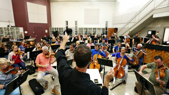 """Springfield Symphony Orchestra music director and conductor Kyle Wiley Pickett signals instructions during a rehearsal of Prokofiev's """"Romeo and Juliet"""" at Evangel University in Springfield, Mo. on Sept. 13, 2016."""