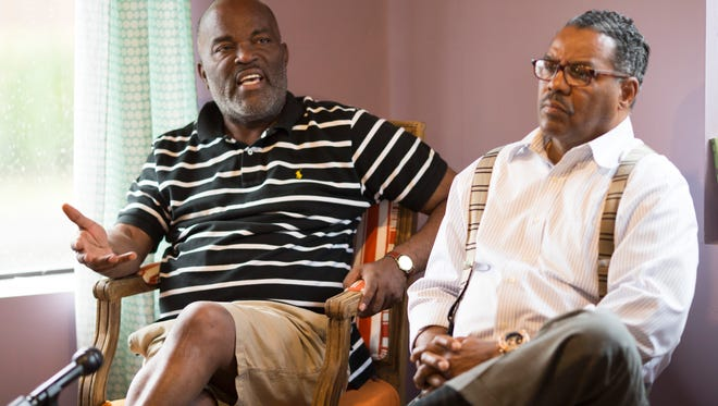 Pastor Gerome Sutton, left, and Rev. Ron D. Robinson talk with media about the recent news surrounding council woman Jessica Green and councilman Dan Johnson. June 23, 2017