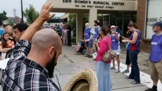 Anti abortion protesters rallied in front of the EMW Women's Surgical Clinic this morning. July 28, 2017.