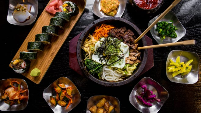 Bibimbap surrounded by banchan, Korean side dishes at Seoul 3501
