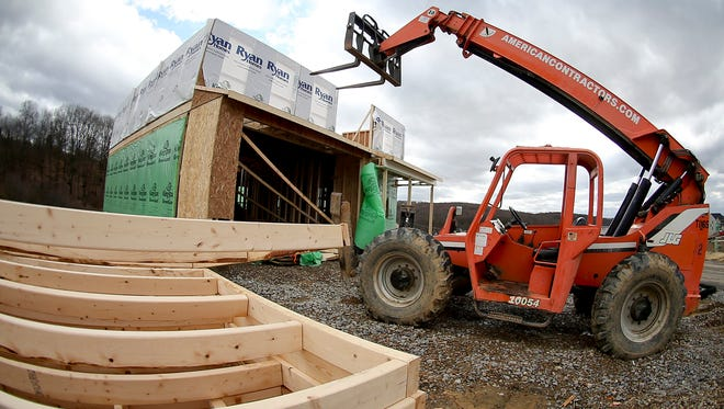 In this Wednesday, March 1, 2017, photo, a forklift is parked in front of one of the houses under construction in a housing plan in Zelienople, Pa. On Wednesday, Aug. 16, 2017, the Commerce Department reports on U.S. home construction in July. (AP Photo/Keith Srakocic)