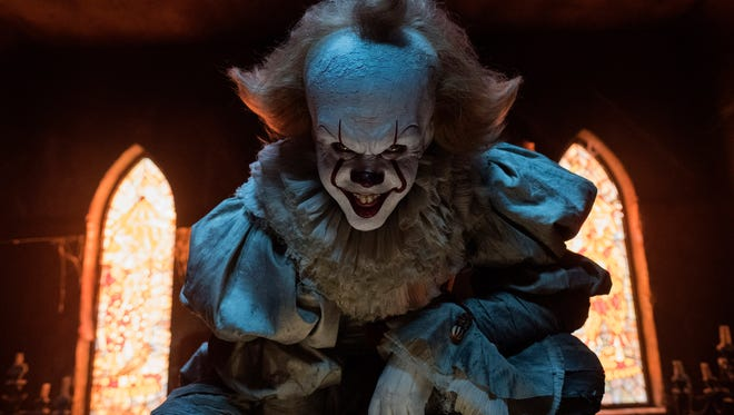 Pennywise (Bill Skarsgård) haunts the residents of Derry in the new film 'It.'
