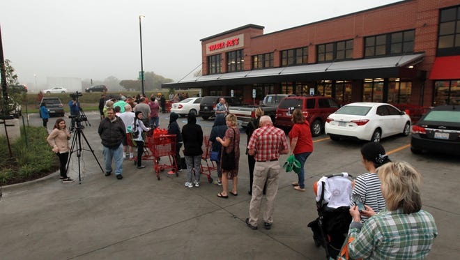 Shoppers wait in line for the grand opening of Trader Joe's in Coralville on Friday, Oct. 6, 2017.