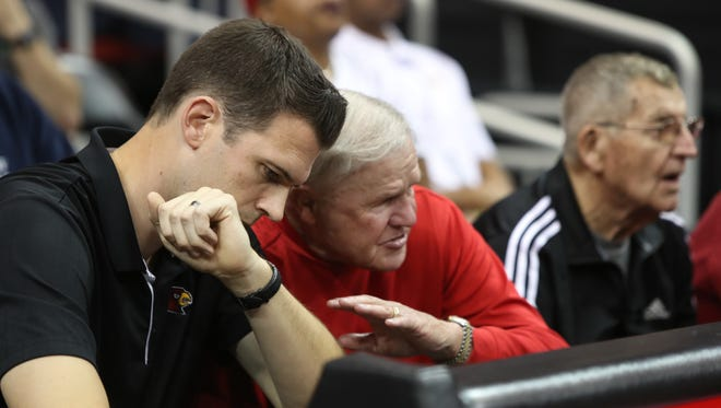 David Padgett, U of L's acting men's basketball coach, left, sat with former head coach Denny Crum during his team's first scrimmage. Oct. 13, 2017.