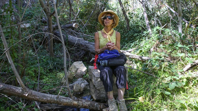 Amanda Frye sits in the west fork of Strawberry Creek in the San Bernardino National Forest, October 11, 2017.