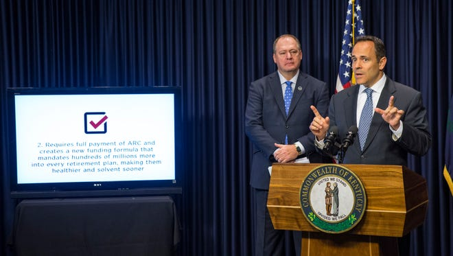 Kentucky Governor Matt Bevin makes a point regarding a state pension reform plan during a press conference at the Capitol. On left is Speaker of the House Jeff Hoover. Oct . 18, 2017.
