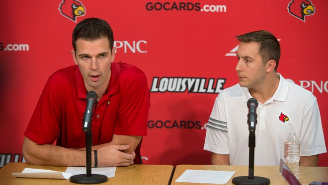 University of Louisville acting men's basketball coach David Padgett, left, introduces new assistant coach Greg Paulus, on right. Oct. 19, 2017.