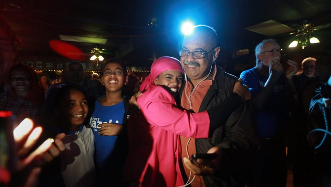 Iowa City City Council candidate Mazahir Salih celebrates her victory with friends and family at the Mill on Tuesday, Nov. 7, 2017.