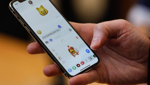 An Apple employee demonstrates the Animoji feature