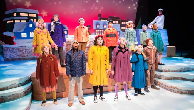"The cast sings in ""A Charlie Brown Christmas,"" performed by First Stage."