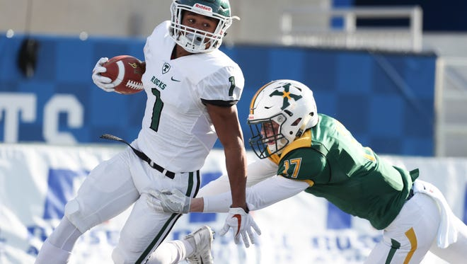 Trinity's Rondale Moore looks to break a tack during the first half against St. Xavier during the Commonwealth Gridiron Bowl held at the UK football stadium on Sunday afternoon. Dec. 3, 2017