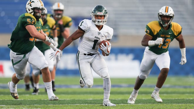 Trinity's Rondale Moore looks for running room in the fourth quarter against St. Xavier during the Commonwealth Gridiron Bowl held at the UK football stadium on Sunday afternoon. Trinity won the state title 28-21. Dec. 3, 2017