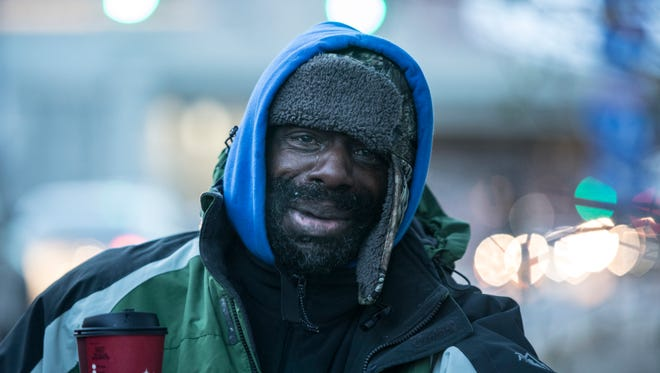"Byron ""Roc"" Peeler shed a tear as his belonging were removed from a homeless camp between Jefferson Street and I-65. Dec. 8, 2017."