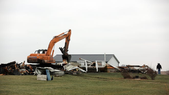 A house is torn down after significant fire damage in rural North Liberty on Wednesday, Dec. 13, 2017.
