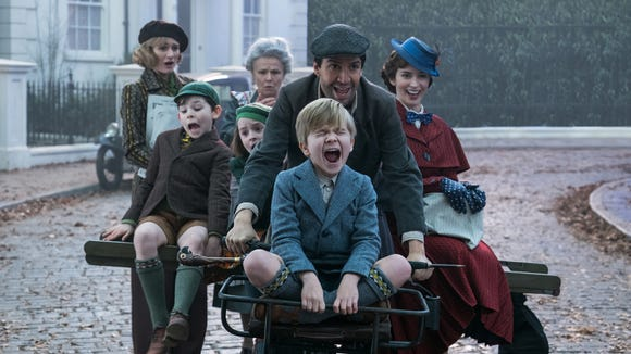 Jane (Emily Mortimer, left), John (Nathanael Saleh), Annabel (Pixie Davies), Ellen (Julie Walters). Jack (Lin-Manuel Miranda) Georgie (Joel Dawson) and Mary Poppins (Emily Blunt) go for a joyride in the musical sequel 'Mary Poppins Returns.'