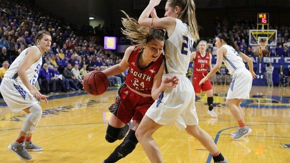 South Dakota's Ciara Duffy (24) drives to the bucket