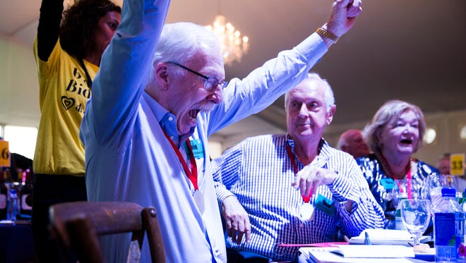 Edward Doherty cheers after winning lot 30, Roaming Above the Clouds, during the Naples Winter Wine Festival Auction on Saturday, January 27, 2018 at the The Ritz-Carlton Golf Resort in Naples, Fla. Lot 30 sold for $160,000.