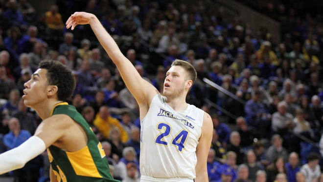 South Dakota State's Mike Daum (5) scores his 2000th career point from the free throw line during the second half of the Jackrabbits' 82-63 victory over North Dakota State Thursday night at Frost Arena in Brookings.
