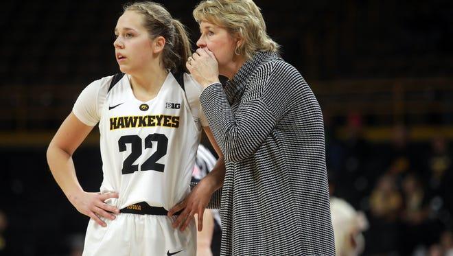 Iowa head coach Lisa Bluder talks to Kathleen Doyle during the Hawkeyes' game against Minnesota at Carver-Hawkeye Arena on Sunday, Feb. 4, 2018.