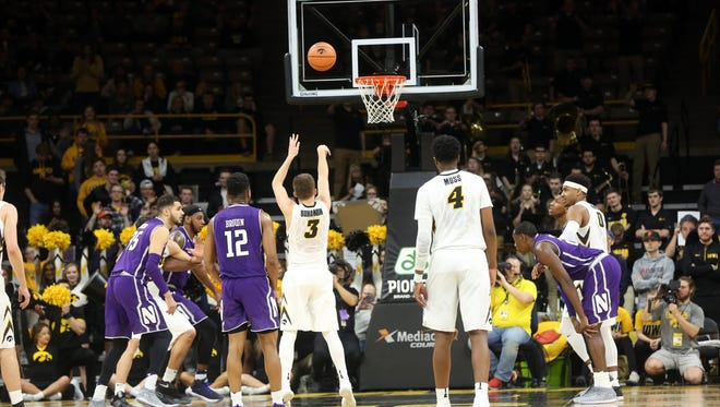 Iowa's Jordan Bohannon shoots a free throw, tying Chris Street's consecutive free throw record, during the Hawkeyes' game against Northwestern at Carver-Hawkeye Arena on Sunday, Feb. 25, 2018.