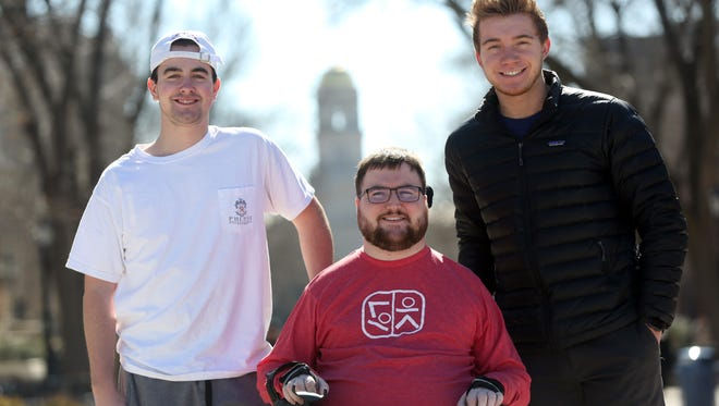 Peter Easler, from left, Michael Penniman and Jacob Newcomb, co-founders of Students Care, pose for a photo on Monday, Feb. 26, 2018. The three started the non-profit organization to aid disabled students in their daily routines to better their college experiences.