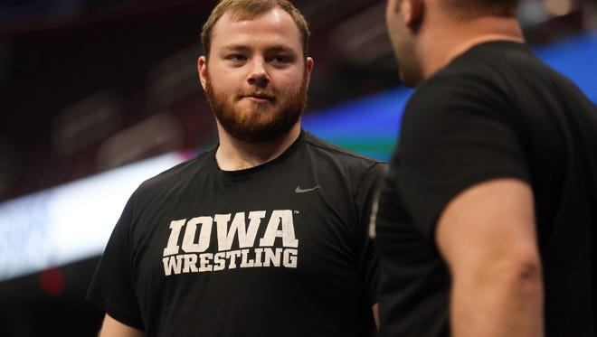 Iowa's Sam Stoll chats with volunteer assistant coach Ben Berhow during a practice session at the NCAA Wrestling Championships at Quicken Loans Arena in Cleveland, Ohio on Wednesday, March 14, 2018.
