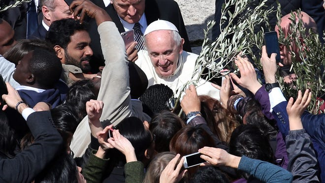 Pope Francis greets faithful as he leaves St. Peter's Square at the the end of Palm Sunday Mass on March 25, 2018 in Vatican City, Vatican.  Pope Francis on Sunday presided at the Procession and Mass for Palm Sunday, as the Church enters into the celebration of Holy Week. Palm Sunday commemorates the triumphal entry of Jesus into Jerusalem one week before His Passion, Death, and Resurrection.