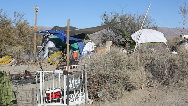 A perimeter fence keeps others away from a homeless person's makeshift home near Dillon Rd and Highway 86.