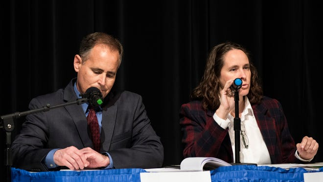 Aaron Starr, left, and his wife Alicia Percell are seen at a 2018 candidates forum in support of an Oxnard recall election. Their nonprofit group Moving Oxnard Forward is suing the city clerk in two lawsuits dealing with a public records request and a proposed ballot initiative.