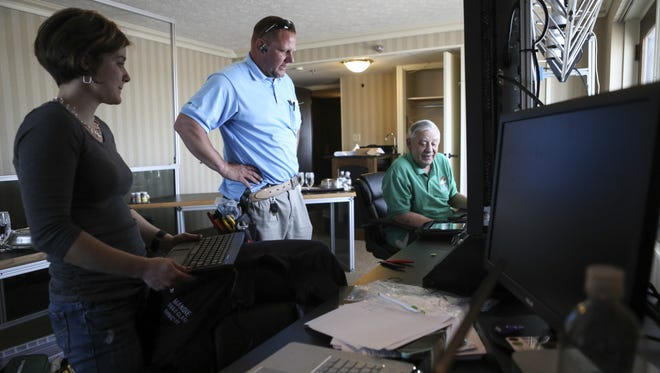 Thunder over Louisville producer Wayne Hettinger, right, is shown here in 2016 with Thunder director Mandie Creed-Clark and AT&T's Kenny Johnson in the Thunder Command Center. Hettinger has produced Thunder each of its 29 years.