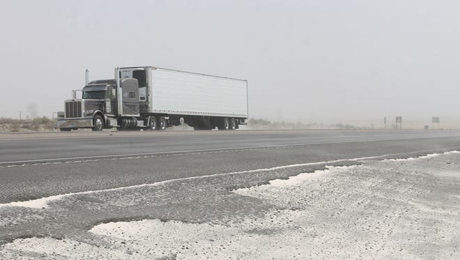 A semi drives through a sandstorm near White Sands National Monument on Highway 70 Friday afternoon. Winds reached up to 40 mph.