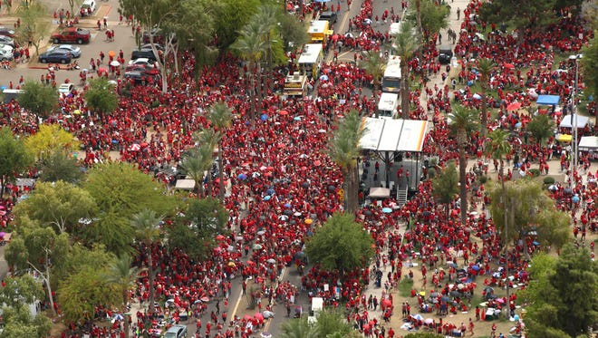 Arizona teachers march to the state Capitol during a walkout for higher pay and more education funding on April 26, 2018, in Phoenix.
