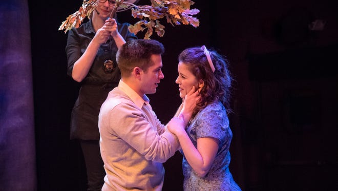 """Keegan Siebken (left) and Susan Wiedmeyer share a tender moment in """"The Fantasticks,"""" staged by In Tandem Theatre."""