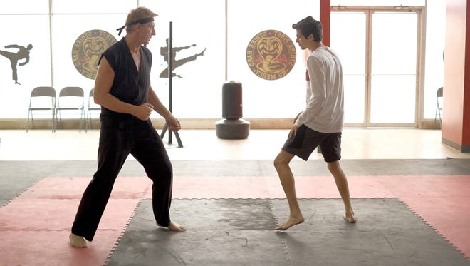 "Johnny (left, William Zabka) trains new student Miguel (Xolo Maridueña) in ""Cobra Kai."""