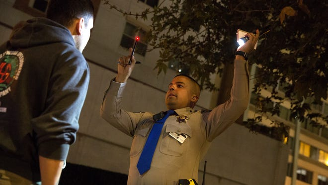 Highway Patrol Officer Benjamin Gomez conducts a sobriety check on an unidentified man after a traffic stop in Los Angeles, California on Friday, April 13, 2018. The man was later arrested for a DUI.