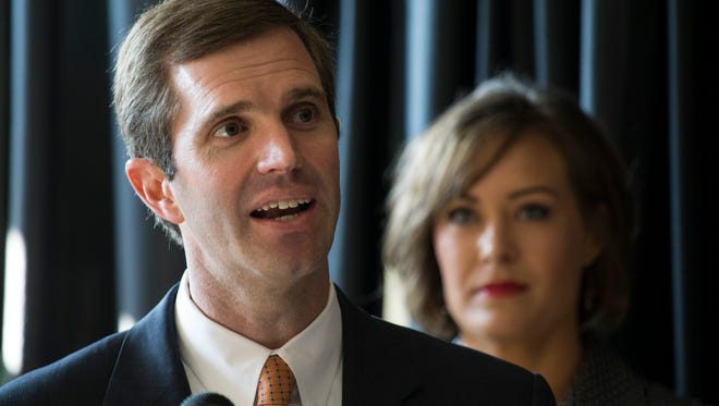 Kentucky attorney general, Andy Beshear, announces his governor candidacy Monday in Louisville, Kentucky as running mate Jacqueline Coleman looks on. July 9, 2018