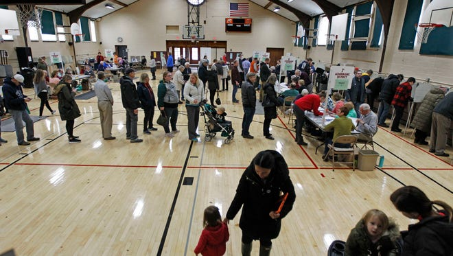 Voters turnout for the mid-term elections to cast the their ballots in November 2018 at the Community Center Gym in Cedarburg. Candidates in Milwaukee's suburbs for the 2020 spring election had to file by Jan. 7.