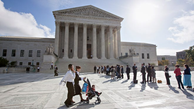 Visitors line up to enter the Supreme Court in Washington, Tuesday, Oct. 14, 2014, as the justices begin the second week of the new term.