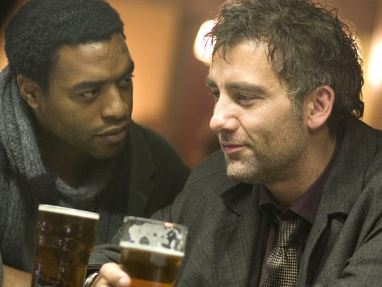 Luke (Chiwetel Ejiofor, left) and Theo (Clive Owen)
