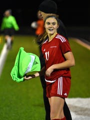 Anna Podojil grabs a towel and looks to celebrate an Indian Hill victory, Nov. 7, 2017.