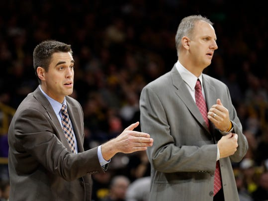North Dakota assistant coach Jeff Horner, left, and head coach Brian Jones, right, direct their team during the first half of an NCAA college basketball game against Iowa, Tuesday, Dec. 20, 2016, in Iowa City, Iowa. (AP Photo/Charlie Neibergall)