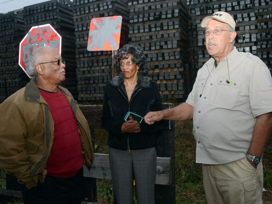 ANI Russel Honore Ret. Lt. Gen. Russel Honore (right) discussed the Stella Jones Facility Tuesday, Dec. 2, 2014 along with Agnes Francisco (center) and Environmental Protection Agency environmental justice Israel Anderson (far left) while visiting the Beth